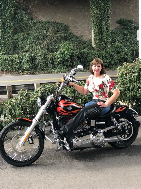 Jacque with Babs (her bike) after losing 80 lbs